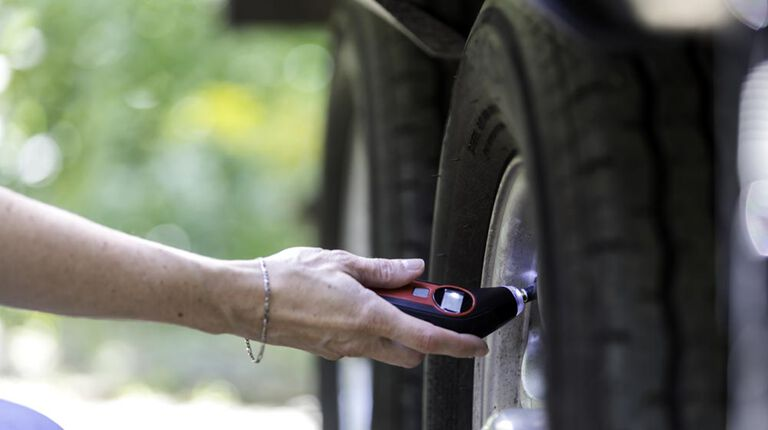 Checking tire pressure on a trailer