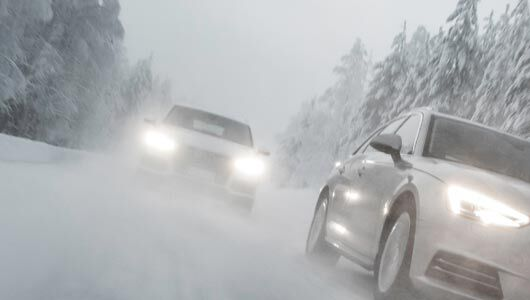 Winter road with vehicles