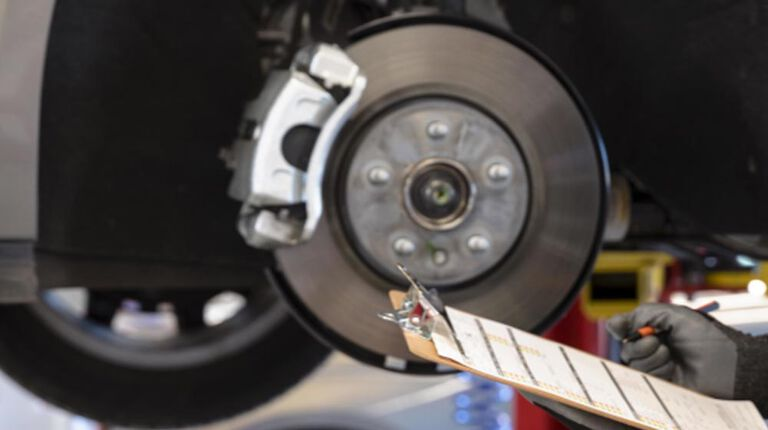 Kal Tire brake inspection on clipboard