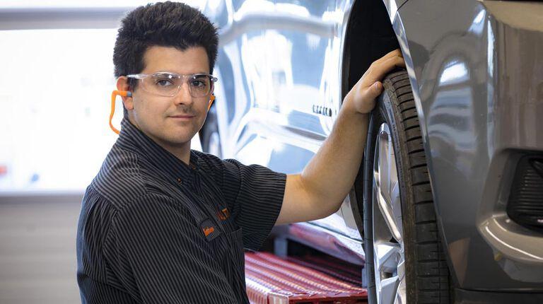 Kal Tire team member rotating tires